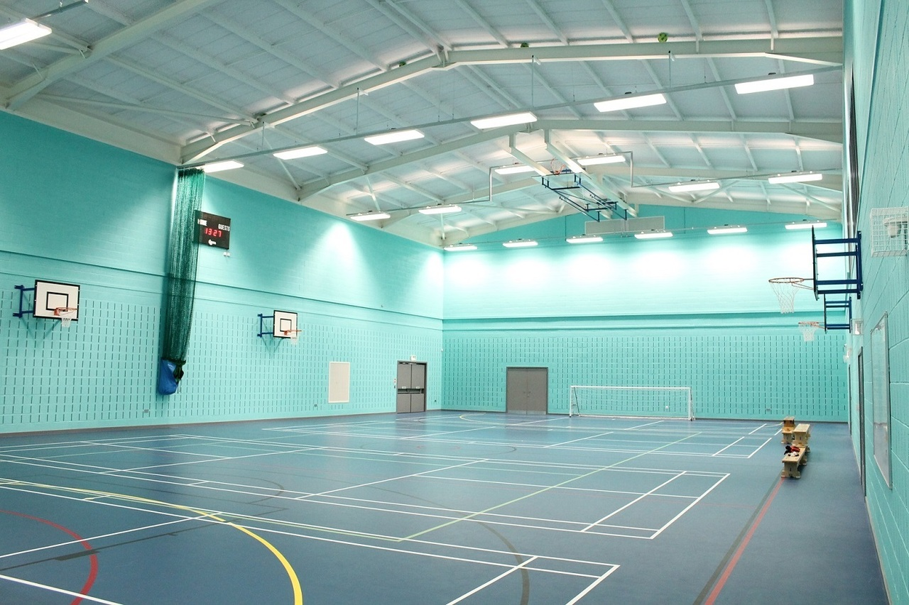 SonaSpray K-13 Special - Decorative acoustic ceiling and wall spray installed in gym